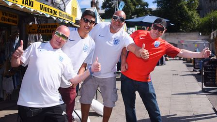 Norwich Market traders ready in their England shirts for the World Cup match. From left, Jockey Mart