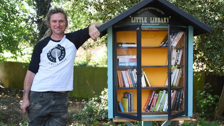 Crispin Kaye-Morrell with the new mini library book swap station he has made, at the Old Library Woo