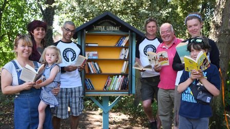 Residents with their new mini library book swap station at the Old Library Wood park area near their