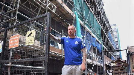 Russell McVey by his scaffolding at Grosvenor House in Prince of Wales Road, which he is refusing to