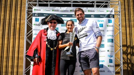 Emma Risbey picks up the ladies' winner's trophy from last year's Run Norwich event. Picture: Epic A