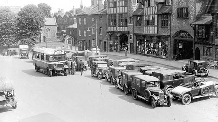 Cars parked on All Saints' Green outside Bonds. This photo was probably taken in the 1930's. Picture