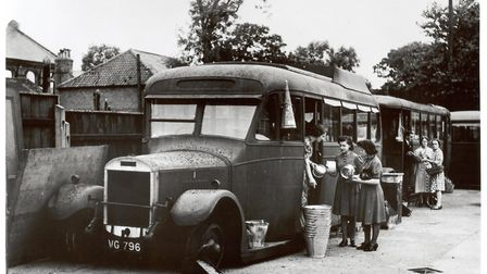 Business as usual following the 1942 Blitz. Bonds trading from buses in former car park in 1942 just