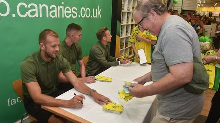 NCFC players, Felix Passlack, Jordan Rhodes and Aston Oxborough, at the Canaries store in Intu Chape