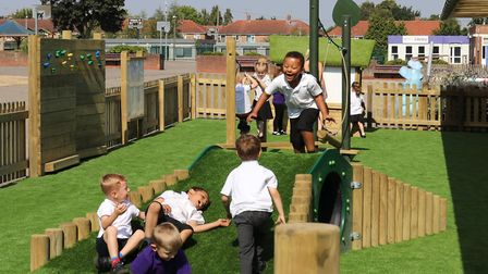 Pupils at Norwich Primary Academy in Clarkson Road get a first taste of their new early years outdoo