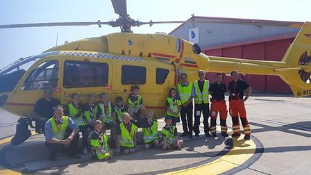 Members of the 3rd and 4th Norwich Sea Scout Group visiting the East Anglian Air Ambulance at Norwic