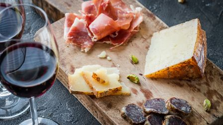 Red wine and a Charcuterie board. Photo: Getty Images/iStockphoto