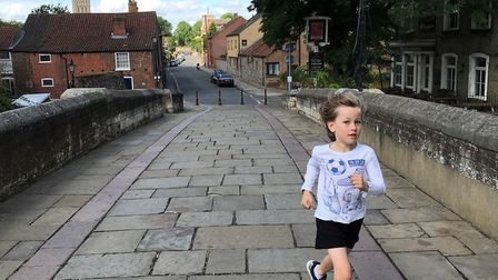 Noah Mckeown, nine, who is running aiming to run 26.2 miles this summer for Leeway domestic abuse ch