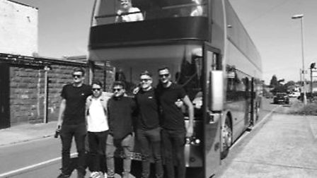 Gamplan infront of the double decker bus they hired to take their fans to London. Photo: Gameplan