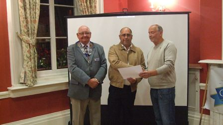 From left, Alan Jude, Graham West (STC works manager) and Tony Lakey (Lions), receiving the award fo