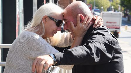 Dawn and Steve Peri, comfort each other after losing their son Ibish. Picture: DENISE BRADLEY