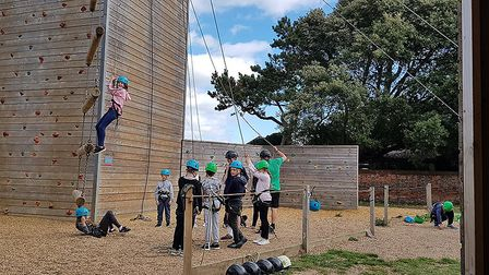Pupils from Norwich Primary Academy tackle high-altitude challenges at Kingswood activity centre