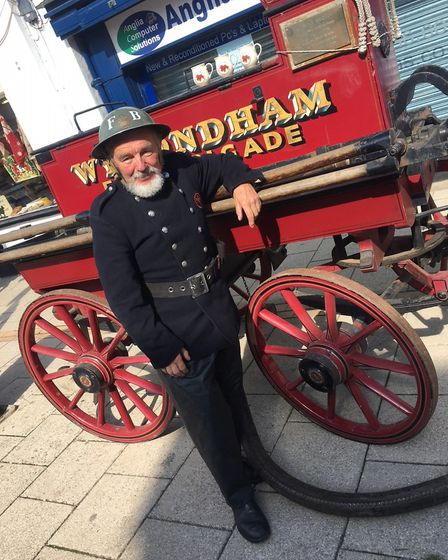 Norfolk Fire Museum volunteer Chris Bonnick with 1882 carriage from Wymondham Fire Brigade. Picture