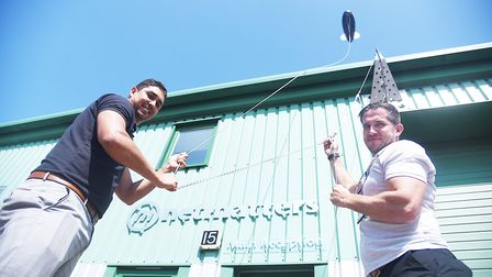 Wymondham company Netmatters are flying a 20-foot blimp from their building. Pictured are (L) Busine