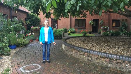 Valerie Roberts standing next an uneven pavement in the Cotman Estate. Picture: Staff