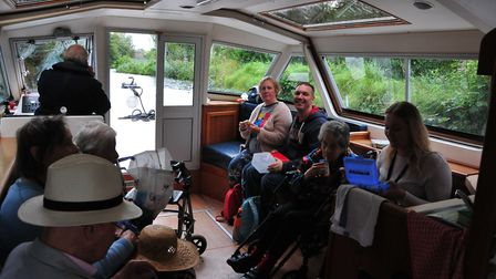 Residents of Manorcourt Homecare enjoy a trip along the Broads from Neatishead.