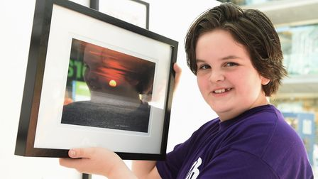Josh Wylie, 11, with his photo of a sunset at Hunstanton which reminds him of his dad, at Life Witho