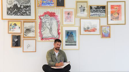 Artist Tom Hill who sketches using both hands, with some of his work for his Masters degree at NUA.