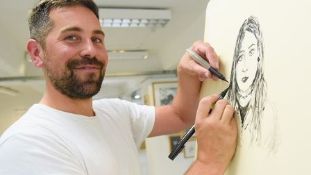 Artist Tom Hill who sketches using both hands, working on a portrait at NUA. Picture: DENISE BRADLEY