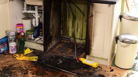 A kitchen damaged by a house fire caused in 2015. Picture: Denise Bradley