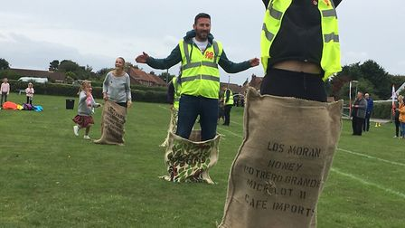 Adults take part in a sack race at the Finnbar's Force community sports day. Picture: Kim Briscoe