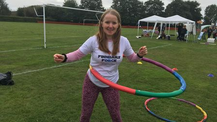 Jayne Fellows tries out the power hoops at the event. Picture: Kim Briscoe