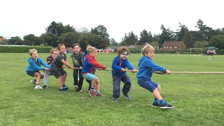 The boys' team in the tug of war at the sports day. Picture: Kim Briscoe