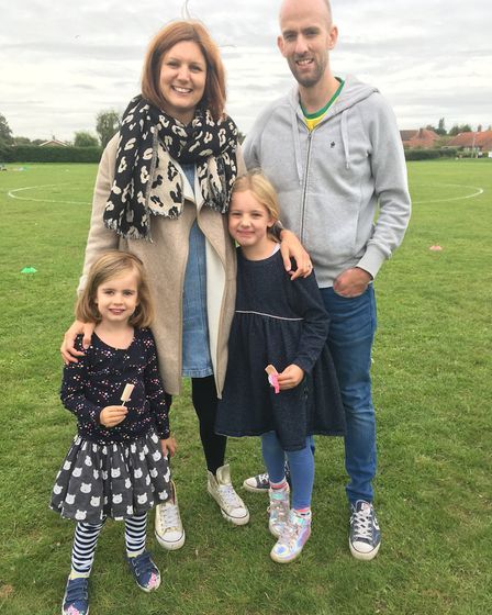 Jess and Matthew Pearson with their daughters Maggie, 4, and Pippa, 6, at the community sports day o