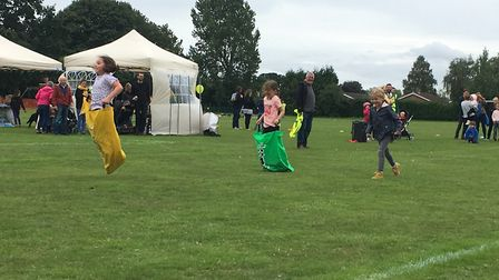 Children's sack race at the event at Hethersett Memorial Playing Field. Picture: Kim Briscoe