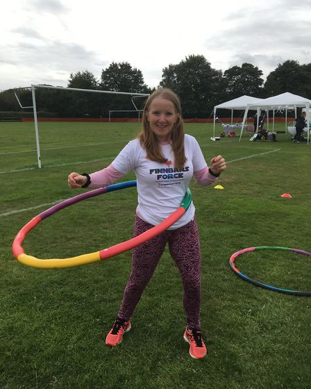 Jayne Fellows tries out the power hoops at the sports day. Picture: Kim Briscoe