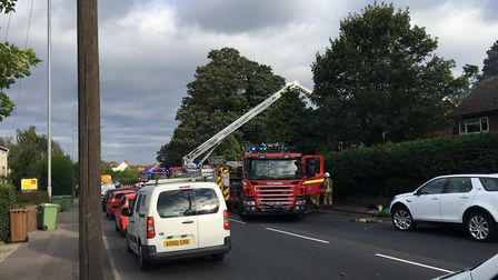 Fire crews at the scene of a house fire on Mousehold Lane in Norwich. Picture Dan Grimmer.