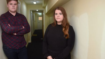 Abigail Nicholson and Daniel Moxon, in the corridor by the front door of their flat in St Faith's La