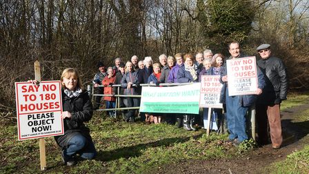 Campaigners pictured outside Wayland Wood in 2016 following the first submission of the 180 home bid