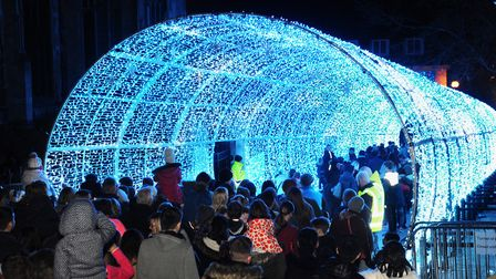 Crowds make their way slowly through the popular Tunnel of Lights at the Norwich Christmas lights sw