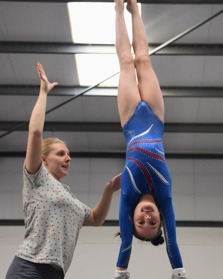 Megan Baxter, eight, during training with coach Naomi Gage, at The Norfolk Academy of Gymnastics at