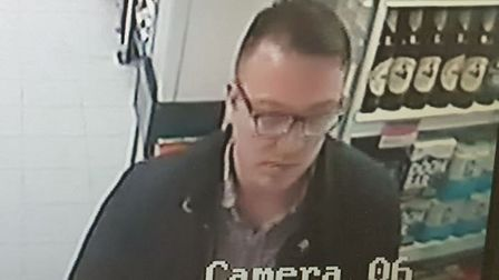 CCTV freezeframe of the man police are attempting to trace following a theft in Norwich.