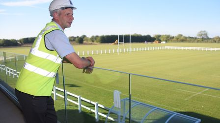 Peter Graves, development committee chairman, on the balcony overlooking the new pitches at the Wymo