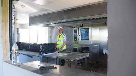Peter Graves, development committee chairman, in the kitchen at the new Wymondham Rugby Club build w
