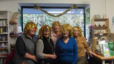 The staff at Hethersett Macmillan Cancer Support shop get into the festive spirit PHOTO: Peter Stewa