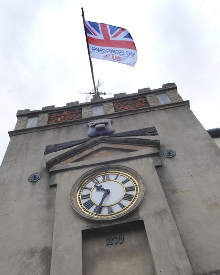 The Union Jack being raised over the clock tower in Watton ahead of Armed Forces Day. Picture:Sonya