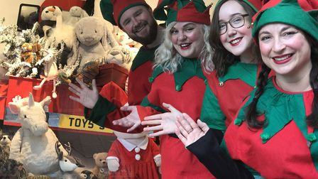 Jarrold's happy elves help to launch their Christmas window reveal. From L-R: Drew Turner, Becky Atk