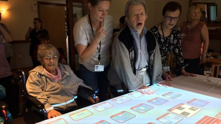 Residents at Hassingham House Care Centre try out the new OMI machine. PHOTO: Sophie Smith