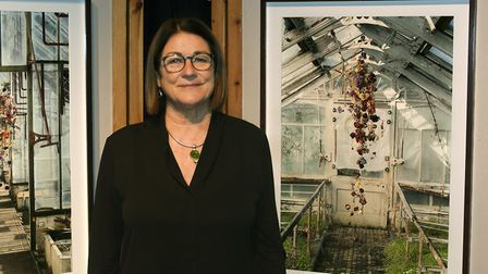 Cathy Warnock with photographs of Rebecca Louise Laws work, The Beauty of Decay series. Photo: Swaff