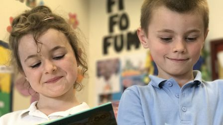 Deanna Read and Jack Fleetwood in the Jack and the beanstalk reading corner. Picture: Neil Didsbury