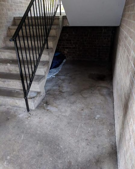 Someone sleeping in a stairwell at Goodman Place. Photo: Submitted