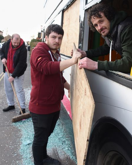 Gavin Goldsmith, left, Jono Thorne, centre, and Karl Connell, members of the Alive Church, work to c