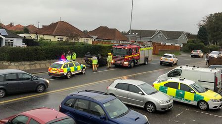 Emergency services attend the scene where a car flipped onto its roof in Hellesdon. Picture:James Ha