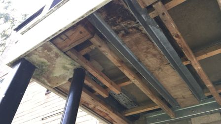 The work saw the ceiling boards above the external stairwells and walkways removed, exposing the woo