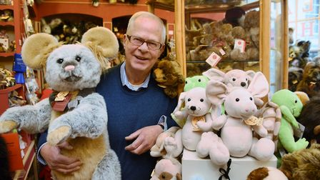 Robert Stone, the proprietor, surrounded by bears at The Bear Shop at Elm Hill, the best known indep