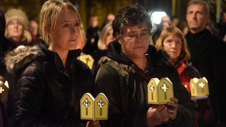 Those in the procession of light, holding their candles at City Hall for the Vigil of Peace for Armi